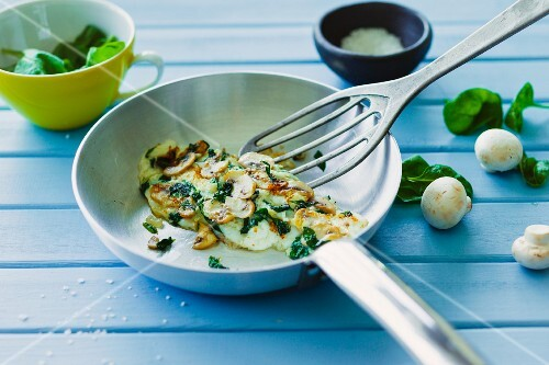 An egg white and mushroom omelette with fresh spinach