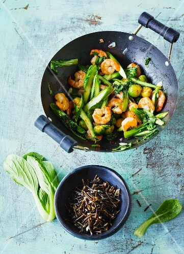 Stir-fried shrimps with green asparagus, bok choy and Brussels sprouts