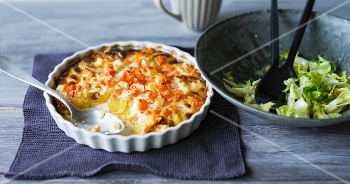 Carrots and potato gratin with celeriac and fresh salad
