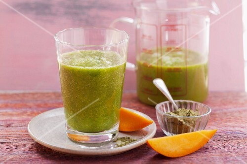 A mango and kale smoothie made with bananas and matcha green tea powder