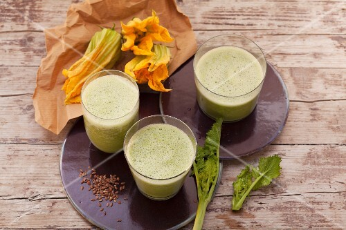 Durian smoothies made with courgette leaves, almonds, dates, kale and buttercups