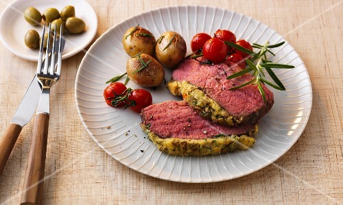 Roast beef with an olive and herb crust