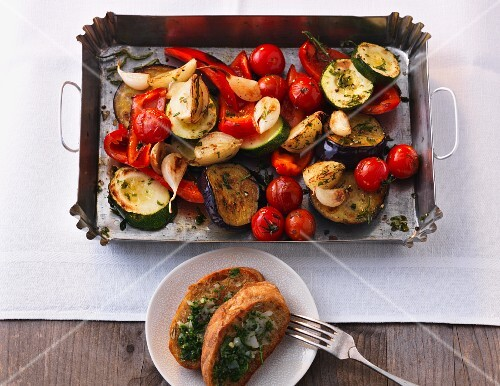 Oven-roasted Mediterranean vegetables with garlic and herb baguette