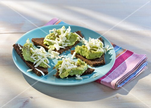 Avocado and canellini bean spread with feta on pumpernikel