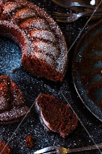 Beetroot chocolate cupcake dusted with icing sugar, sliced