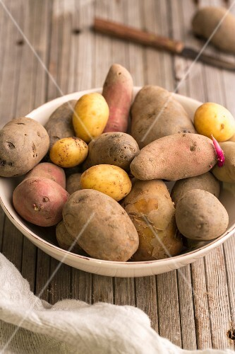 Various types of potatoes in a bowl