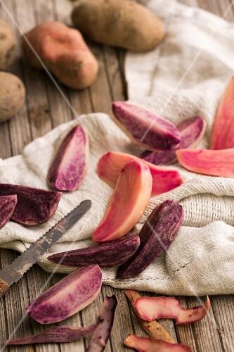 Sliced purple potatoes on a tea towel
