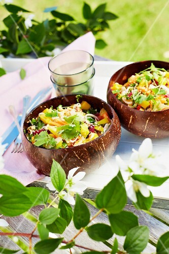 Thai salad made from pepper, mango, beetroot and bean sprouts with almonds
