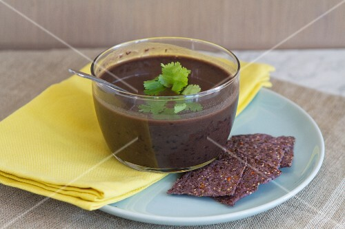 Cuban black bean soup with coriander and flax seed crisps