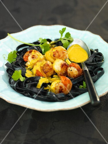 Squid pasta with scallops and saffron sauce