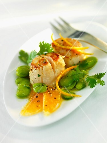 Fried scallops with fava beans and oranges