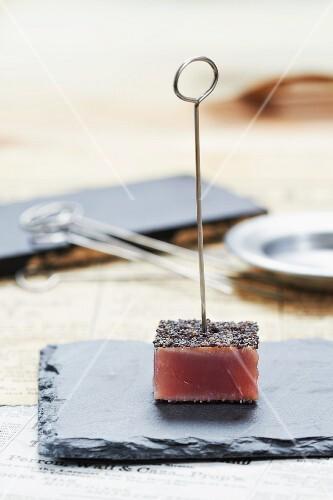 A tuna fish cube with poppyseeds (Japan)