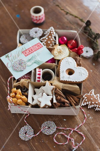 Various Christmas biscuits and Christmas decorations in an old box