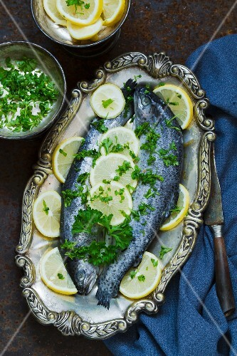 Two trout with lemon and parsley