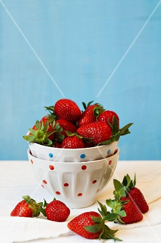 Fresh strawberries in a dotted bowl