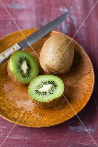 Kiwis on a wooden plate