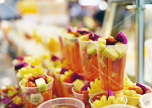 Fruit and vegetable cocktails in plastic cups
