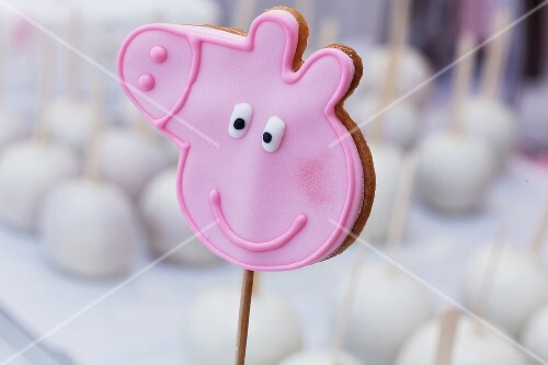 A pick pig biscuit on a stick