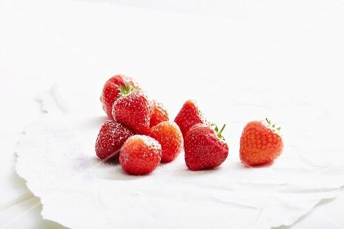 Strawberries on white paper