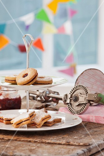 Shortbread biscuits with a jam filling on a cake stand