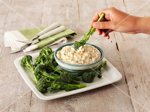 A cheese and chive dip with broccoli