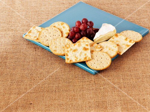 Crackers, Camembert cheese and grapes