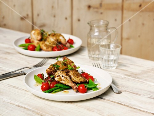 Half a herb chicken with tomatoes and mange tout