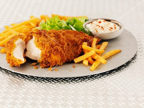 Hot and spicy chicken breast with chips, salad and mayonnaise