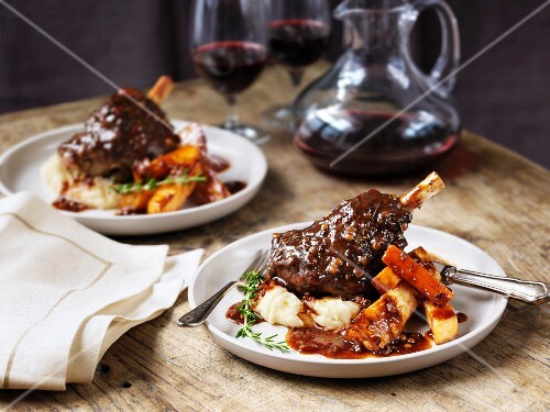 Lamb shanks with mashed potatoes, parsnips, gravy and wine