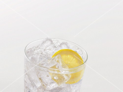 Lemonade in a glass with fresh lemon