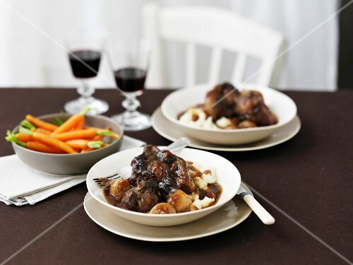 Oxtail and onion stew with carrots and mashed potatoes