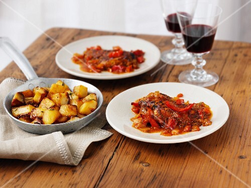 Piri-piri chicken with roast potatoes and wine