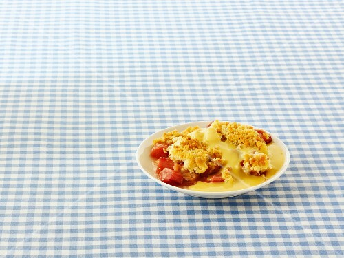 Rhubarb crumble with vanilla sauce