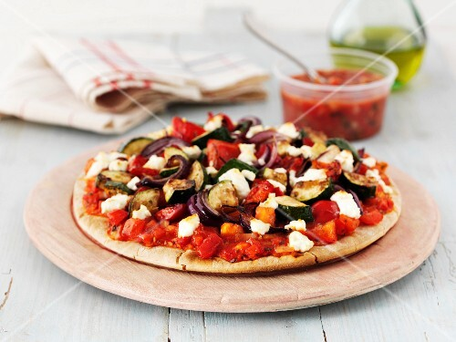 Mediterranean vegetable pizza with feta cheese and salsa