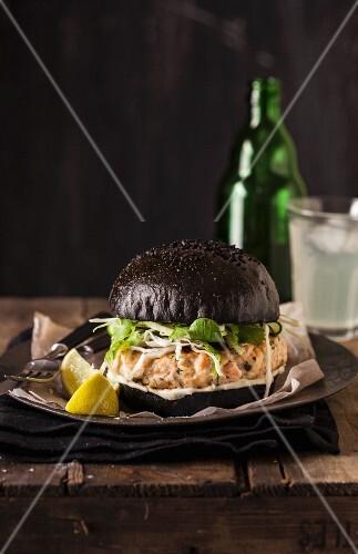 Salmon burger with a black brioche roll