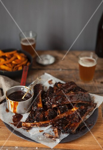Grilled ribs glazed with BBQ with sauce served with chips