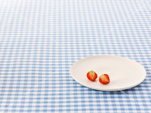 A halved strawberry on a plate