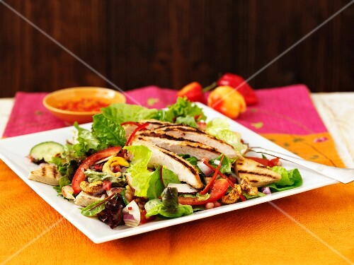 Warm chicken salad with chilli peppers and cashews