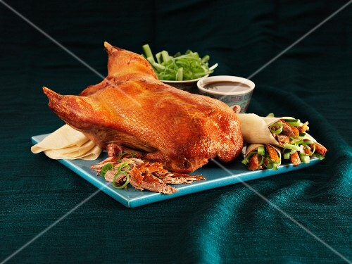 Peking duck with pancakes, cucumber and spring rolls (China)