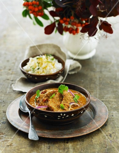 Pork in a red curry sauce with coriander and rice