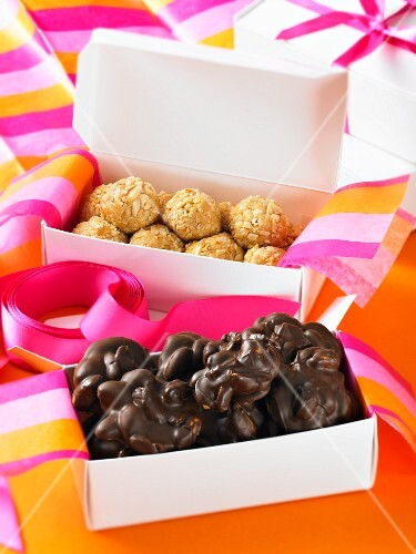 Various pralines in gift boxes