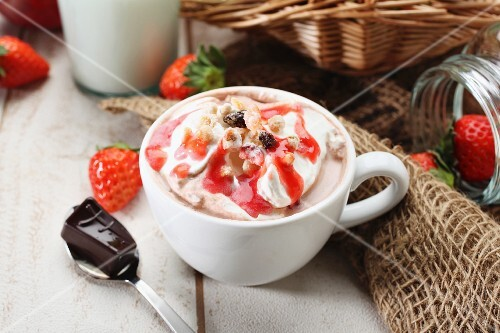 Cocoa with cream and strawberry sauce