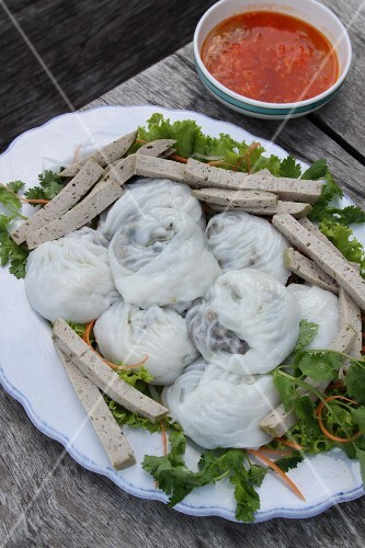 Stuffed noodle dumplings with strips of sausage