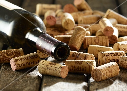 Wine cork and empty wine bottle