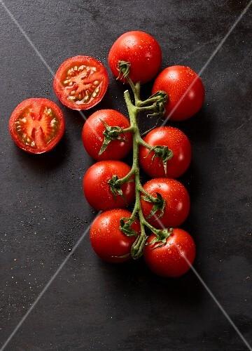 Vine tomatoes, one halved