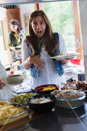 Woman gasping at a party buffet