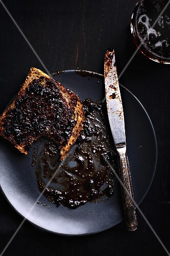 A slice of bread with blueberry jam