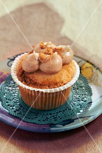 A cupcake on a doily