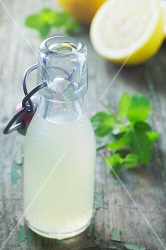 Lemonade in a flip-top bottle on green a wooden surface