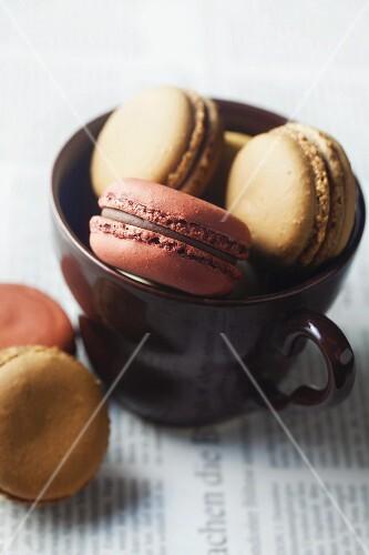 Macaroons in a brown tea cup